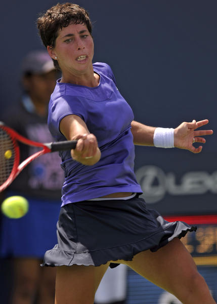 Carla Suarez Navarro of Spain returns a shot from Sara Errani of Italy during second round action Tuesday at the New Haven Open at Yale tennis tournament. Suarez Navarro lost in straight sets 4-6, 3-6.