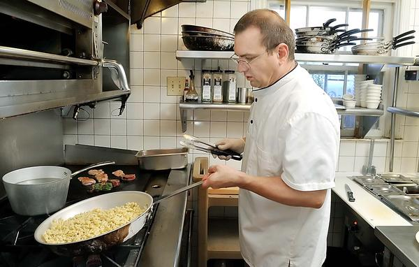 Dieter Blosel, executive chef and owner of Schmankerl Stube, sautees spaetzle in the kitchen at the downtown Hagerstown restaurant.