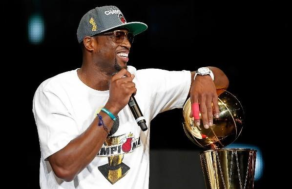The Miami Heat's Dwyane Wade addresses fans during his team's NBA Championship pep rally at American Airlines Arena June 25, 2012 in Miami, Florida.