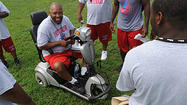 From his wheelchair, Larry Mitchell guides Patterson football team