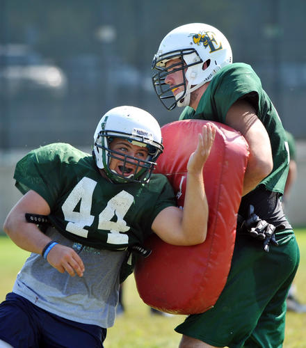 Emmaus High School Football team's Thomas Alcaro (44) runs a drill while being blocked by Ethan Hovanic(59) during a morning high school football practice on Tuesday.