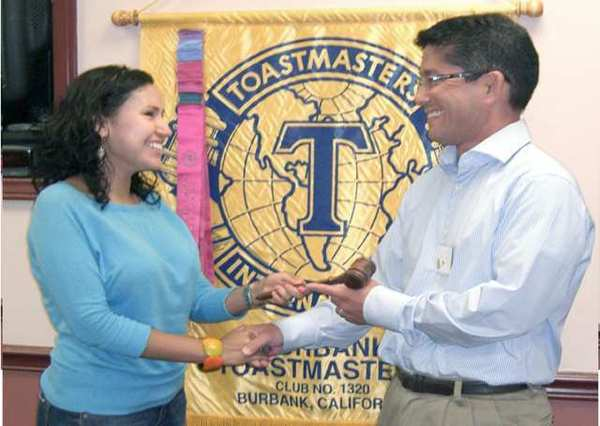 Viviana Ardila passes the gavel to Gary Monji who succeeds her aspresident of the Burbank Toastmasters Club 1320. (photo by BarbaraMassey)
