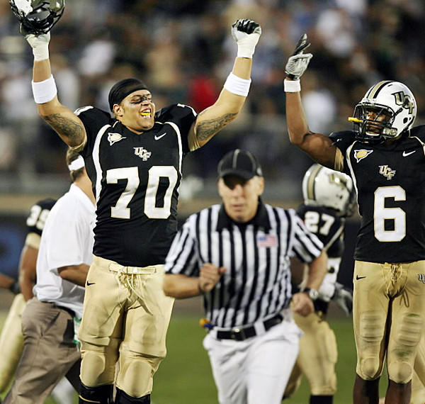 UCF offensive lineman Chris Martin (70) and wide receiver Brian Watters (6) celebrate after winning the East Carolina at UCF football game at Bright House Networks Stadium on Saturday, October 30, 2010.