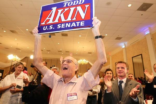 GOP Senate hopeful Todd Akin wowed supporters, above, during his primary victory this month. But the candidate's recent comments have sent the party into a tizzy, with leaders begging him to quit the race.