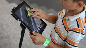 Ads may spur unhappy kids to embrace materialism