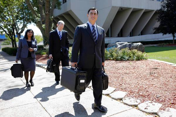 Christopher Vaughn's defense attorney, George Lenard, right, leaving the Will County Courthouse in Joliet, told jurors Tuesday that evidence will show the deaths Vaughn's wife, Kimberly, and their three children were a murder-suicide committed by Kimberly.