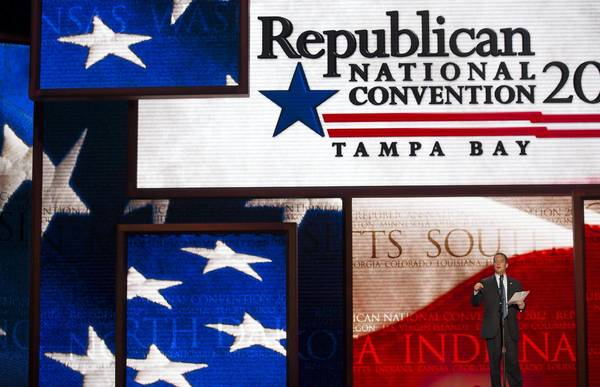 RNC Chairman Reince Priebus unveils the stage for next week's convention in Tampa, Fla. Delegates will want to pack a few essentials — sunscreen, a bathing suit and a sidearm.