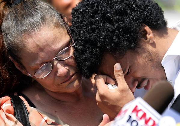 Ronald Weekley Jr., a college student from Venice, is comforted by his mother, Diana Holquin, when he breaks down during a news conference to talk about his encounter with Los Angeles police officers.
