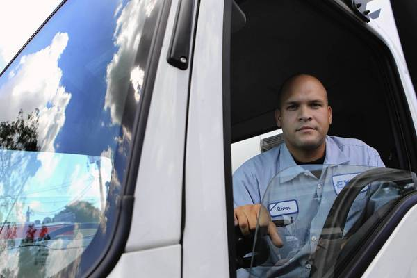 Steve Lopez, shown here Tuesday in his delivery truck, was arrrested five years ago by Chicago police Officer Richard Fiorito as he was driving home early one morning from a family gathering. He fought the DUI charge, and four months ago the city settled with him for $100,000. The city also will pay his legal fees.