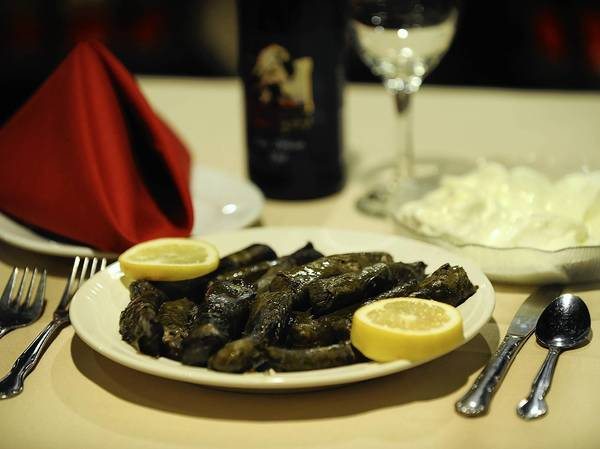 Violette Younes uses lamb, rice and spices to make stuffed grape leaves at Aladdin Restaurant in Allentown.
