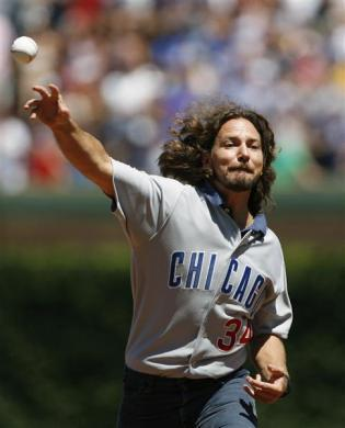 Pearl Jam's lead singer Eddie Vedder throws out the first pitch before a New York Mets and Chicago Cubs game in Chicago, August 3, 2007.