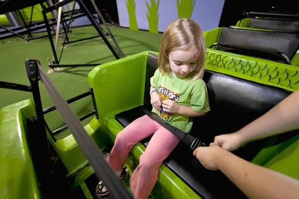 A ride operator checks the safety belt worn by Gwendolyn Duncan, 4, as she prepares to ride the Python Pit at Zonkers in Olathe, Kan. Jayson Dansby, 3, was killed when he fell out of a similar roller coaster at an entertainment center in Norridge last year. Zonkers had added seat belts to the ride about two years ago.
