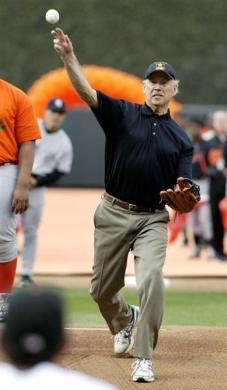 Vice President Joe Biden throws out the ceremonial first pitch before the start of the Baltimore Orioles opening day game against the New York Yankees in Baltimore, April 6, 2009.