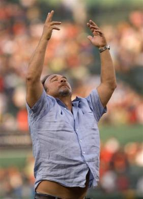James Belushi responds to cheers before throwing out the first pitch before a game between the Boston Red Sox and the Los Angeles Angels at Fenway Park, August 17, 2007.