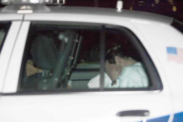 Darien police officers transport Jacob Nodarse or Johnny Borizov from the Darien Police Department in Darien, Ill. after the two were charged in the murders.