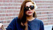 • Lady Gaga arrived in Amsterdam debuting a pretty new shade of light brown hair