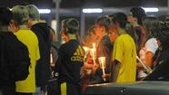 More than 250 gather at vigil for train derailment victims