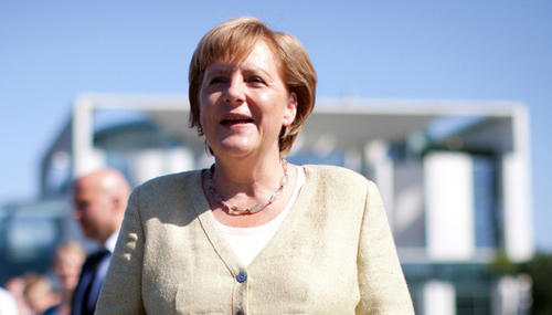 German Chancellor Angela Merkel smiles during an open house event at the chancellery on Aug. 19 in Berlin.