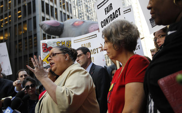 Chicago Teachers Union president Karen Lewis joins picketing union members outside the Chicago Public Schools headquarters at 125 S. Clark St. in Chicago today.