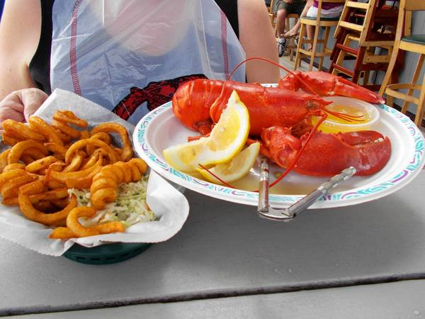 Boiled Maine lobster and spicy curly fries at Bill's Seafood Restaurant in Westbrook.