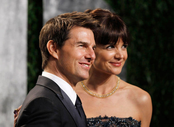 Actor Tom Cruise and actress Katie Holmes, arrive at the 2012 Vanity Fair Oscar party in West Hollywood, California February 26, 2012.