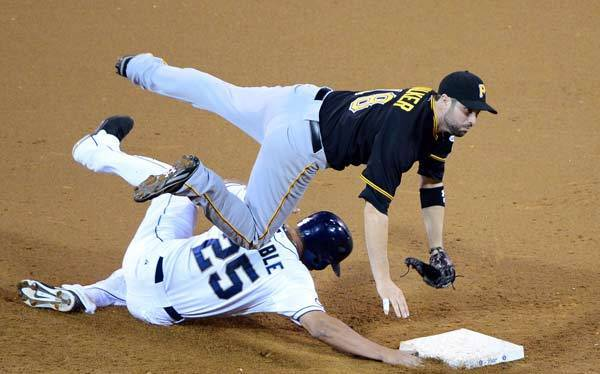 Pittsburgh Pirates second baseman Neil Walker (18) turns a double play over San Diego Padres right fielder Will Venable (25) to end the sixth inning at Petco Park.