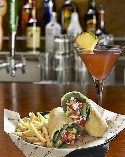 fl-food-dining-scene-082312 .The Diva martini and grilled veggie wrap at Bar Louie in West Palm Beach. ..Handout photo provided by: Bar Louie/Courtesy