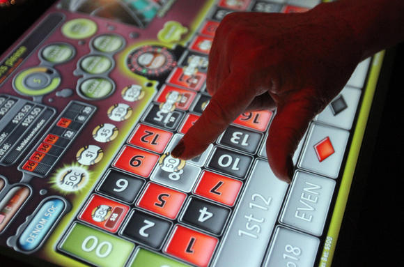 Players use a touch-screen to place their bets.