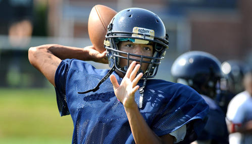 In Notre Dame of Green Pond High School football practice Wednesday quarterback Kordell Theadford looks for a receiver.