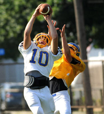 In Wilson High School football practice Wednesday Ryan Dailey (10) pulls in a pass.