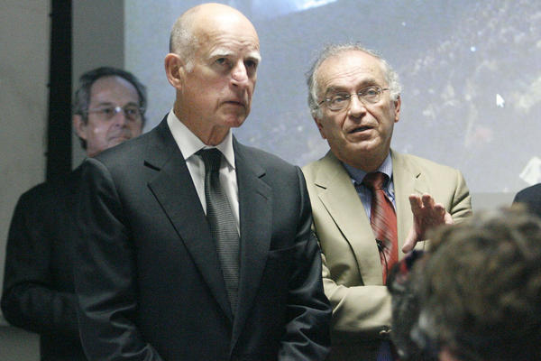 Gov. Jerry Brown, from left, listens to JPL Director Charles Elachi as they watch footage from Aug. 5, when the rover Curiosity landed on Mars.