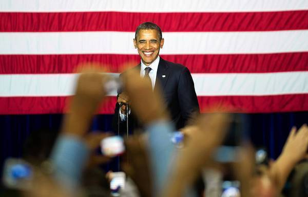 President Obama, beaming before a crowd in Las Vegas, has a slight lead over Republican presidential candidate Mitt Romney in a new nationwide poll.