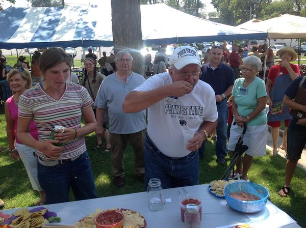 Michael Kusko Jr., a member of the Franklin County Master Gardeners, serves as a judge for the salsa contest Wednesday at the Master Gardeners annual Tomato Tasting Day in Chambersburg, Pa. Kusko was one of the judges because he was the top winner in 2011.