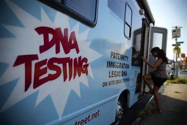 "A woman enters the ""Who's Your Daddy?"" DNA testing van in the Bronx neighborhood of New York August 16, 2012. The van, belonging to Jared Rosenthal, founder of Health Street, drives around the city offering portable DNA paternity testing as well as drug and alcohol testing services."