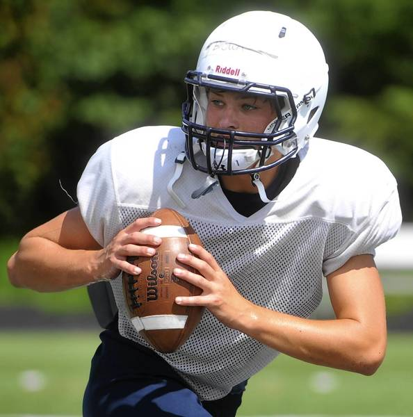Salisbury quarterback Derek Brownruns through drills during football practice held on Monday.