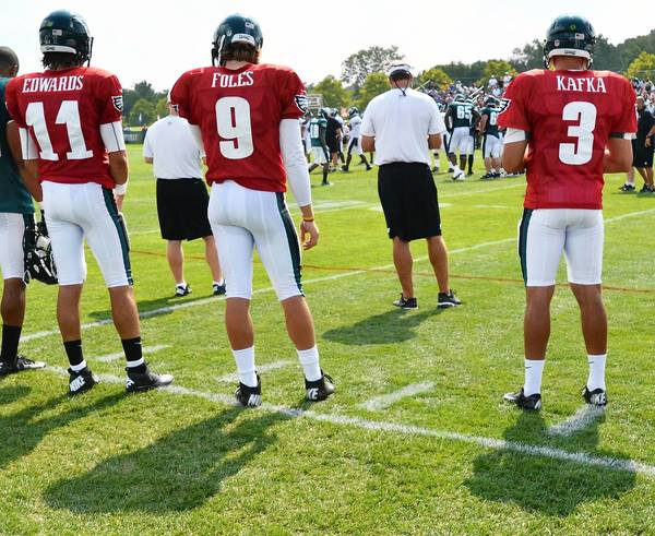 Philadelphia Eagles' quarterbacks Trent Edwards (11), left, Nick Foles (9), and Mike Kafka (3) watch and wait during Eagles Training Camp held at Lehigh University's Athletic Complex on Saturday, August 11, 2012.