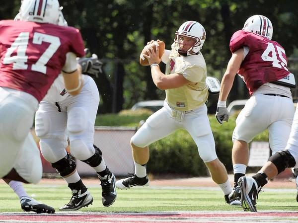 Lafayette's Andrew Shoop (7) tries to avoid a sack during a Lafayette College football scrimmage on Wednesday afternoon at Fisher Field in Easton.