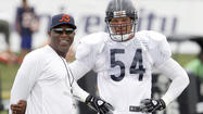Back to being a Pro Bowl grump Wednesday at Halas Hall, Brian Urlacher refused to clarify the mysterious circumstances surrounding treatment of his injured left knee.