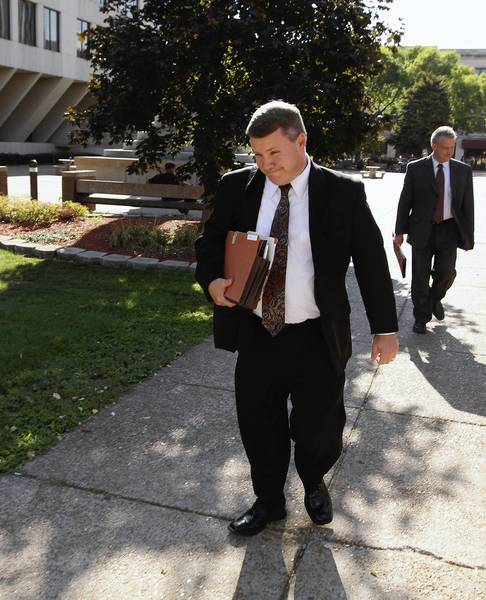 Prosecutor Michael Fitzgerald leaves the Will County Courthouse Wednesday after another day in the Christopher Vaughn murder trial.