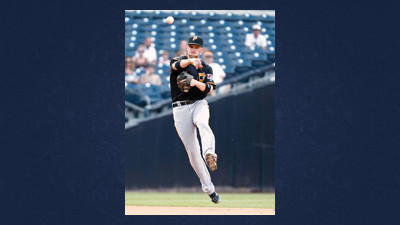 Pittsburgh Pirates shortstop Clint Barmes makes a running throw to first after fielding a ground ball hit by San Diego Padres' Carlos Quentin during the seventh inning of a baseball game on Wednesday in San Diego. Barmes got the out.