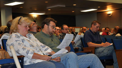 Terri Ann Dovey and her husband Joseph Marisa react to the Conemaugh Township supervisors' vote Wednesday night.