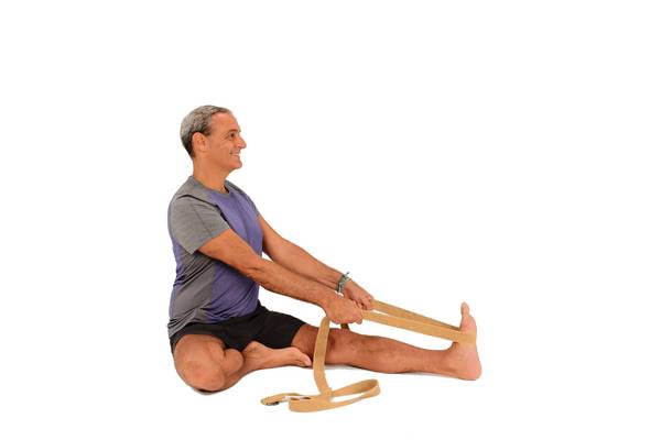 Use a strap to help you maintain a straight spine and if you have sensitive knees or tight hips, place your foot against your inner knee instead of your inner thigh.