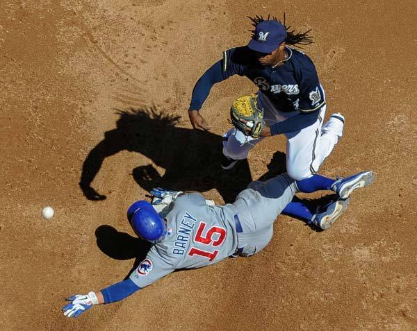 Milwaukee Brewers second baseman Rickie Weeks (23) forces out Chicago Cubs second baseman Darwin Barney (15) in the third inning at Miller Park.