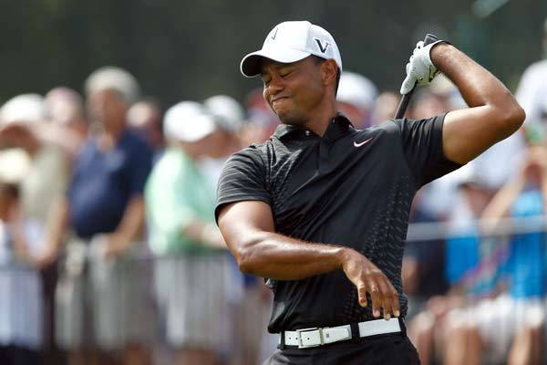 Tiger Woods reacts after teeing off on the 1st hole during the first round of The Barclays at Bethpage State Park.