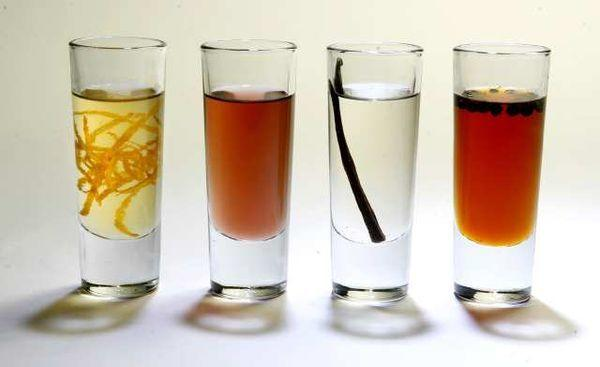 Simple syrup variations, from left: orange, cassis, vanilla and cinnamon pepper caramel syrup.