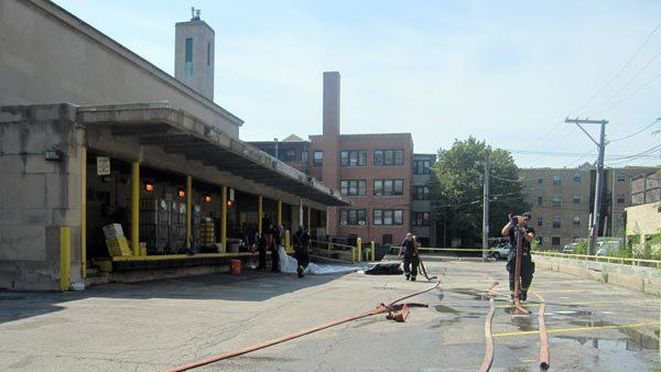 Evanston firefighters clean up following a hazardous materials investigation at the Evanston Post Office, 1101 Davis St., on Thursday. A suspicious powder discovered on a package was determined to be Middle Eastern cooking spices.