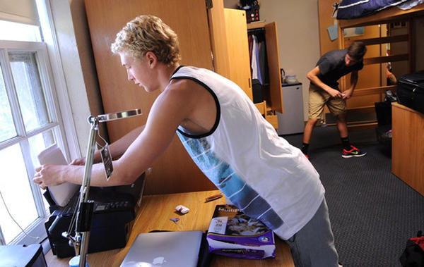 New freshmen roommates move into their dorm room in South College at Lafayette College Thursday. At left is Justin Hoot, 17, of Hermosa Beach, Ca., and at right is Scott Bradley, 18, of Shamokin, Pa..