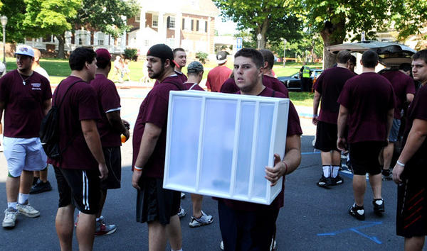 Freshman football player Patrick Narus of Harrisburg joins with other members of the Lafayette football team as they help other freshmen students move into South College dormitory at Lafayette College Thursday.