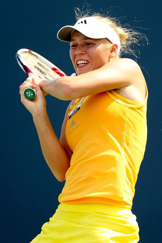 Caroline Wozniacki of Denmark returns a shot to Dominika Cibulkova of Slovakia during the New Haven Open at Yale at the Connecticut Tennis Center at Yale on August 23, 2012 in New Haven