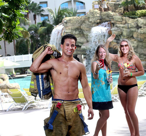 Hollywood firefighter Ronny Arvelo, 24, at the Seminole Hard Rock Hotel & Casino Hollywood photographed with Ashely Harris, 24, center, and Amber Harris, 21, right, both of Palm Beach Gardens.